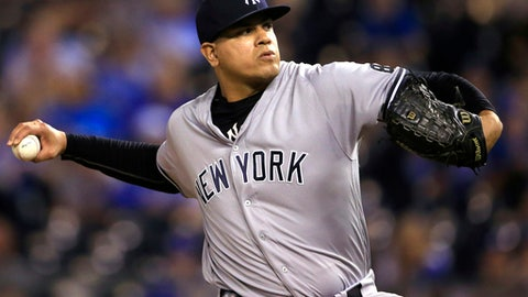 """FILE - In this Aug. 31, 2016, file photo, New York Yankees relief pitcher Dellin Betances delivers to a Kansas City Royals batter during the 13th inning of a baseball game at Kauffman Stadium in Kansas City, Mo. The Yankees plan to go to salary arbitration with Betances, which would be the team's first hearing in nearly a decade. """"We're not going to reach a resolution with Dellin,"""" Yankees general manager Brian Cashman said Thursday, Jan. 19, 2017. """"Based on all our discussions it was clear that the different perspectives were such a wide bridge.""""(AP Photo/Orlin Wagner, File)"""