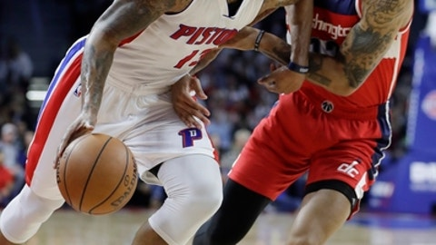 Detroit Pistons forward Marcus Morris (13) drives on Washington Wizards forward Kelly Oubre Jr. during the first half of an NBA basketball game, Saturday, Jan. 21, 2017, in Auburn Hills, Mich. (AP Photo/Carlos Osorio)