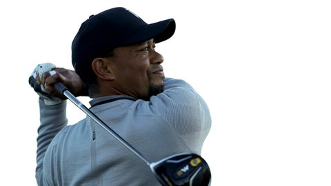 Tiger Woods watches his tee shot on the fifth hole of the north course during the Pro-Am event of the Farmers Insurance Open golf tournament Wednesday, Jan. 25, 2017, in San Diego. (AP Photo/Gregory Bull)