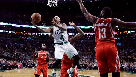 Boston Celtics guard Isaiah Thomas (4) drives to the basket against Houston Rockets guard James Harden (13) during the first quarter of an NBA basketball game in Boston, Wednesday, Jan. 25, 2017. (AP Photo/Charles Krupa)