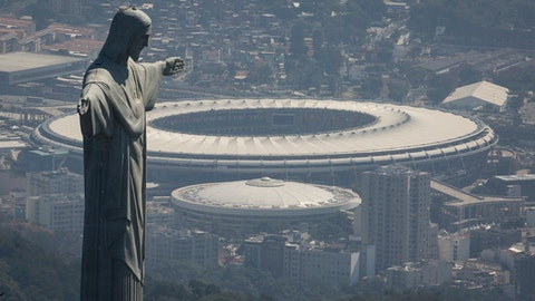 FILE - In this  Aug. 1, 2016, file photo, the Christ the Redeemer statue stands above Maracana stadium in Rio de Janeiro, Brazil. Electricity has been cut at Rio de Janeiro's Maracana stadium in a battle over unpaid bills. The electric utility company says in a statement that power was cut on Thursday, Jan. 26, 2017, which was host of the 2014 World Cup final, and the opening a closing ceremonies of Rio's 2016 Olympics. (AP Photo/Felipe Dana, File)