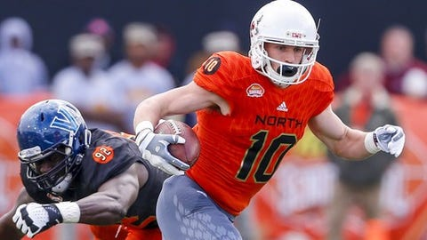 North squad wide receiver Cooper Kupp of Eastern Washington (10) carries the ball as he gets around South squad defensive end Tanoh Kpassagnon of Villanova (92) during the first half of the Senior Bowl NCAA college football game, Saturday, Jan. 28, 2017, at Ladd-Peebles Stadium in Mobile, Ala. (AP Photo/Butch Dill)