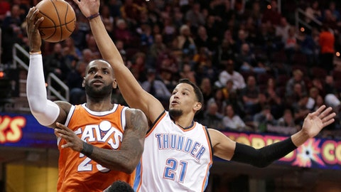 Cleveland Cavaliers' LeBron James (23) drives to the basket against Oklahoma City Thunder' Andre Roberson (21) in the first half of an NBA basketball game, Sunday, Jan. 29, 2017, in Cleveland. (AP Photo/Tony Dejak)