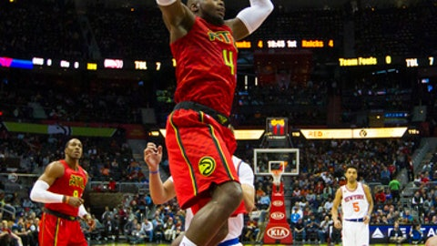 Atlanta Hawks forward Paul Millsap (4) dunks in the first half of an NBA basketball game against the New York Knicks on Sunday, Jan. 29, 2017, in Atlanta. (AP Photo/Todd Kirkland)