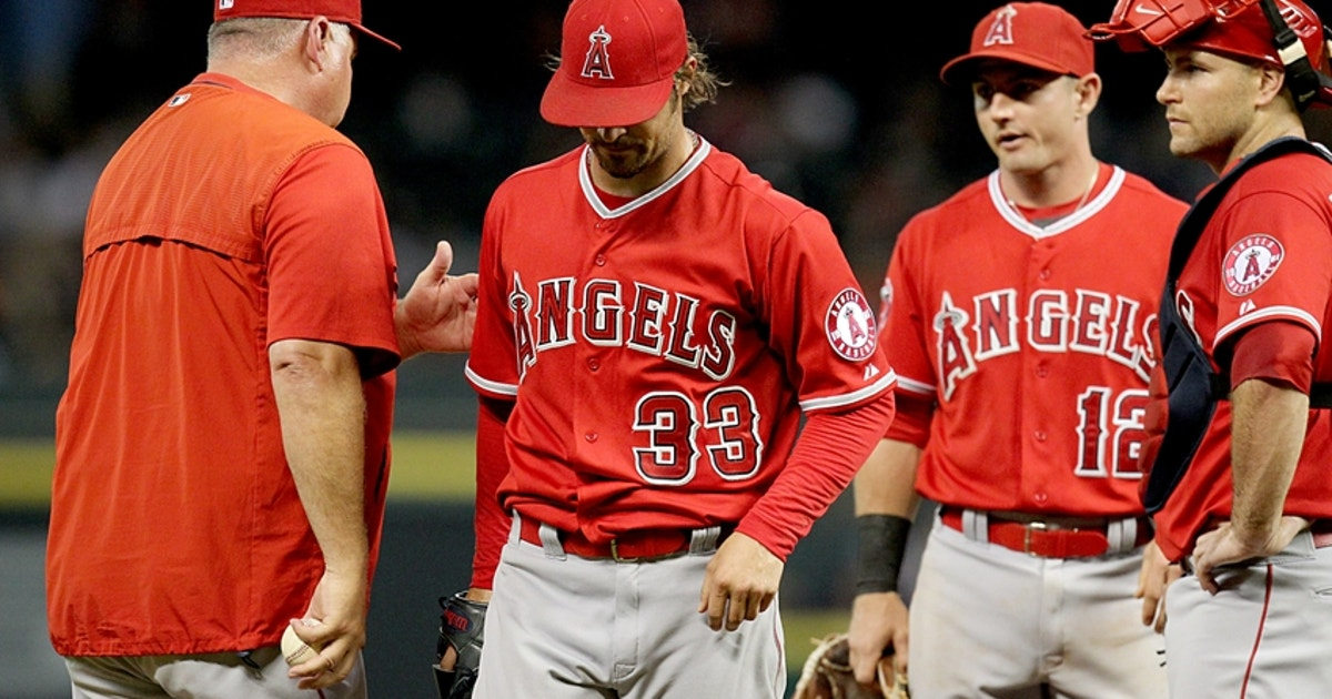 8722778-mike-scioscia-c.j.-wilson-mlb-los-angeles-angels-houston-astros.vresize.1200.630.high.0