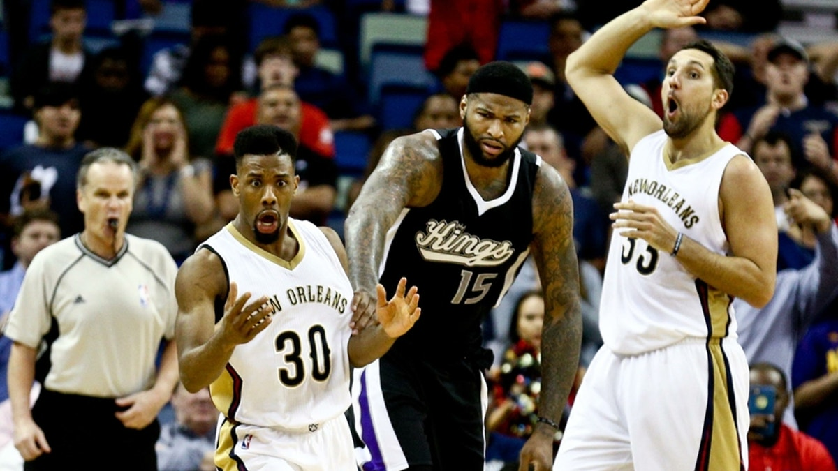 9166797-norris-cole-demarcus-cousins-ryan-anderson-nba-sacramento-kings-new-orleans-pelicans.vresize.1200.675.high.0