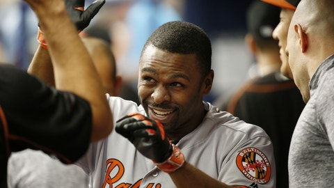 Sep 7, 2016; St. Petersburg, FL, USA;  Baltimore Orioles center fielder Michael Bourn (1) is congratulated in the dugout by teammates after  hitting a home run during the third inning against the Tampa Bay Rays against the Tampa Bay Rays at Tropicana Field. Mandatory Credit: Kim Klement-USA TODAY Sports