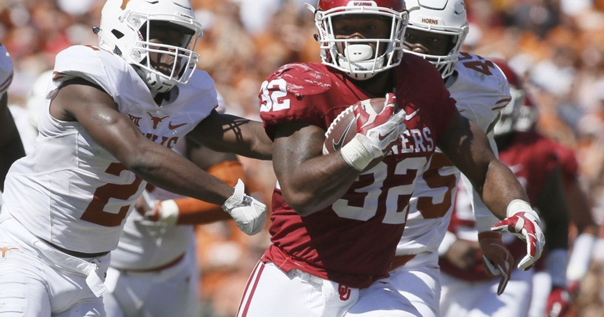 9595376-samaje-perine-kris-boyd-ncaa-football-texas-oklahoma.vresize.1200.630.high.0