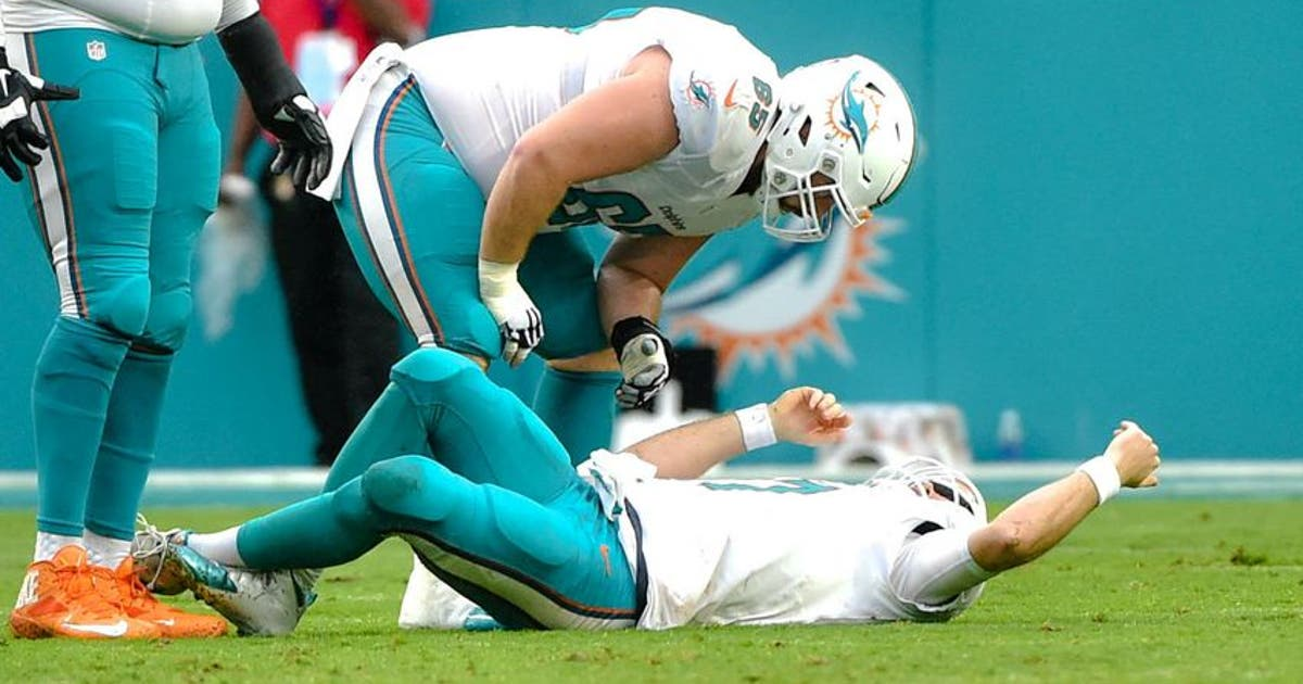 9741415-ryan-tannehill-anthony-steen-nfl-arizona-cardinals-miami-dolphins-2.vresize.1200.630.high.0