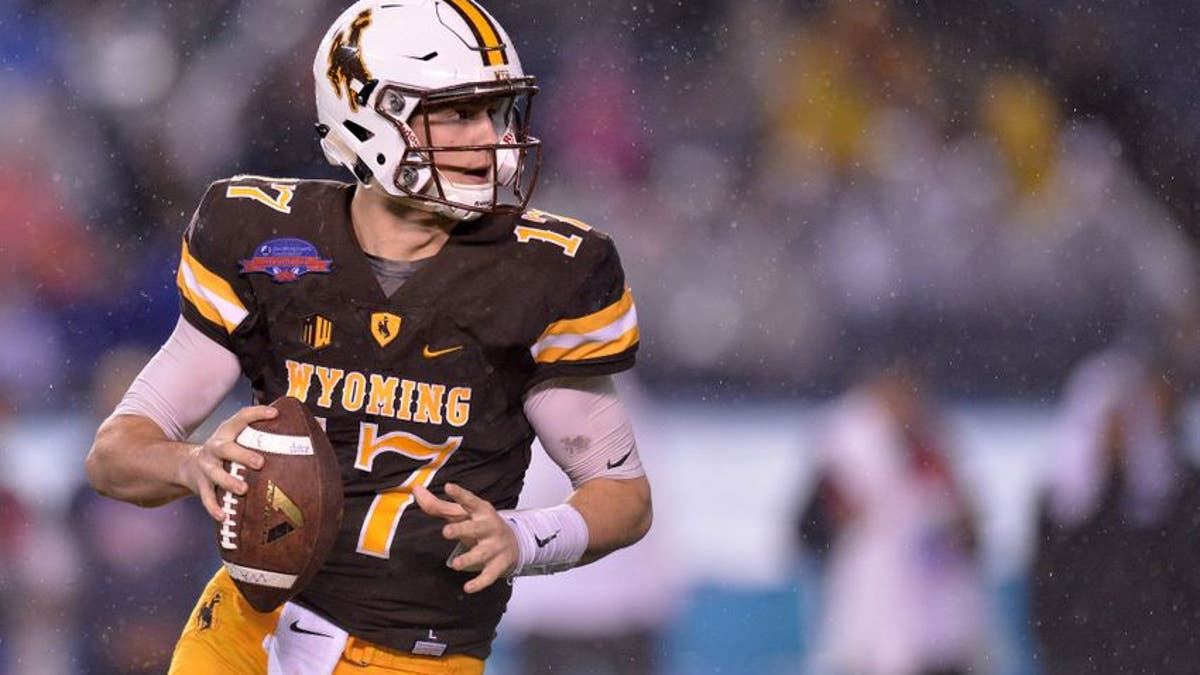 9761630-josh-allen-ncaa-football-poinsettia-bowl-brigham-young-vs-wyoming.vresize.1200.675.high.0