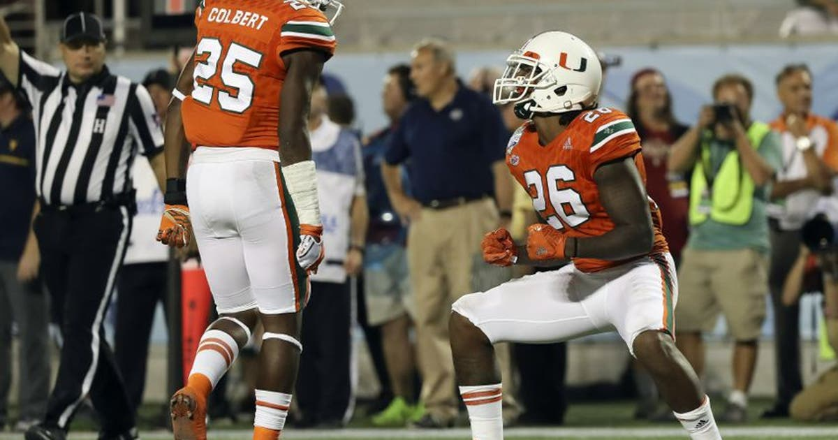 9773022-rayshawn-jenkins-ncaa-football-russell-athletic-bowl-west-virginia-vs-miami.vresize.1200.630.high.0