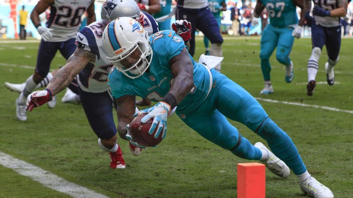 9781364-patrick-chung-jarvis-landry-nfl-new-england-patriots-miami-dolphins.vresize.1200.675.high.0