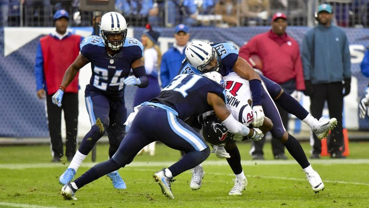 9782292-wesley-woodyard-kevin-byard-keith-mumphery-nfl-houston-texans-tennessee-titans.vresize.1200.675.high.0