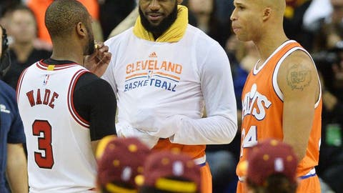 Jan 4, 2017; Cleveland, OH, USA; Chicago Bulls guard Dwyane Wade (3) talks with Cleveland Cavaliers forward LeBron James (23) and forward Richard Jefferson (24) during the second half at Quicken Loans Arena. The Bulls won 106-94. Mandatory Credit: Ken Blaze-USA TODAY Sports