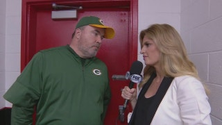 Erin Andrews with Mike McCarthy after NFC Championship loss
