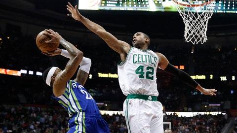 Atlanta Hawks forward Kent Bazemore (24) goes in for a shot as Boston Celtics center Al Horford (42) defends during the second half of an NBA basketball game Friday, Jan. 13, 2017, in Atlanta. Boston won 103-101. (AP Photo/John Bazemore)