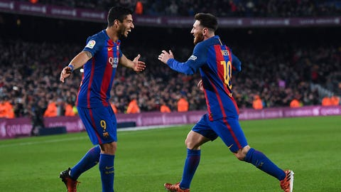BARCELONA, SPAIN - DECEMBER 18:  Lionel Messi (R) of FC Barcelona celebrates with his team mate Luis Suarez after scoring his team's fourth goal during the La Liga match between FC Barcelona and RCD Espanyol at the Camp Nou stadium on December 18, 2016 in Barcelona, Spain.  (Photo by David Ramos/Getty Images)