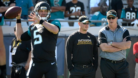 Jacksonville Jaguars interim head coach Doug Marrone, right, watches quarterback Blake Bortles (5) warm up before an NFL football game against the Tennessee Titans in Jacksonville, Fla., Saturday, Dec. 24, 2016. (AP Photo/Phelan M. Ebenhack)