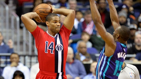Dec 19, 2015; Washington, DC, USA;  Washington Wizards guard Gary Neal (14) looks to move the ball as Charlotte Hornets guard Kemba Walker (15) defends during the first quarter at Verizon Center. Mandatory Credit: Tommy Gilligan-USA TODAY Sports