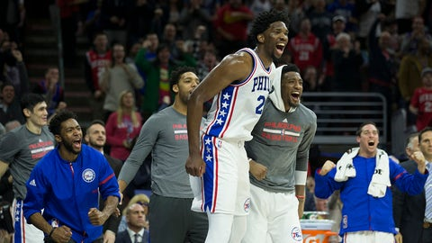 PHILADELPHIA, PA - JANUARY 18: Joel Embiid #21, Chasson Randle #5, Jahlil Okafor #8, Robert Covington #33, and T.J. McConnell #1 of the Philadelphia 76ers celebrate from the bench against the Toronto Raptors at the Wells Fargo Center on January 18, 2017 in Philadelphia, Pennsylvania. The 76ers defeated the Raptors 94-89. NOTE TO USER: User expressly acknowledges and agrees that, by downloading and or using this photograph, User is consenting to the terms and conditions of the Getty Images License Agreement. (Photo by Mitchell Leff/Getty Images)