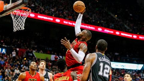 Jan 1, 2017; Atlanta, GA, USA; Atlanta Hawks forward Paul Millsap (4) grabs a rebound against the San Antonio Spurs in the fourth quarter at Philips Arena. The Hawks won 114-112 in overtime. Mandatory Credit: Brett Davis-USA TODAY Sports