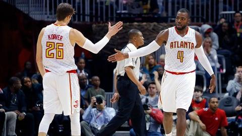 Atlanta Hawks guard Kyle Korver (26) and forward Paul Millsap (4) react in the second half of an NBA basketball game against the Detroit Pistons on Friday, Dec. 30, 2016, in Atlanta. The Hawks won the game 105-98. (AP Photo/Todd Kirkland)
