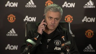 Jose Mourinho answers the phone during press conference
