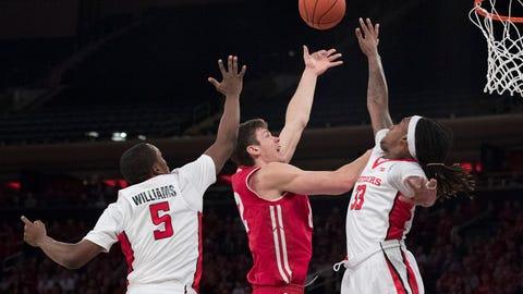 Happ helps No. 15 Wisconsin survive Rutgers