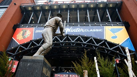 The Stan Musial statue framed by Blues and Blackhawks logos
