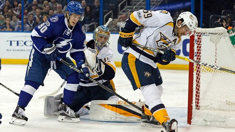 Nashville Predators' Roman Josi (59), of Switzerland, clears the puck after goalie Pekka Rinne, of Finland, made a save on Tampa Bay Lightning's Vladislav Namestnikov, of Russia, during the second period of an NHL hockey game Thursday, Jan. 5, 2017, in Tampa, Fla. (AP Photo/Mike Carlson)