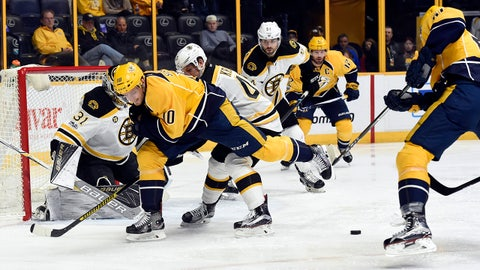 Nashville Predators left wing Austin Watson, right, scores a goal against Boston Bruins goalie Zane McIntyre (31) during the second period of an NHL hockey game Thursday, Jan. 12, 2017, in Nashville, Tenn. (AP Photo/Mark Zaleski)