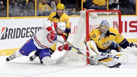 Montreal Canadiens right wing Alexander Radulov (47), of Russia, shoots against Nashville Predators goalie Pekka Rinne (35), of Finland, as Roman Josi (59), of Switzerland, follows during the first period of an NHL hockey game, Tuesday, Jan. 3, 2017, in Nashville, Tenn. (AP Photo/Mark Humphrey)