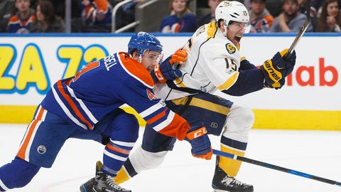 Nashville Predators' Craig Smith (15) and Edmonton Oilers' Kris Russell (4) race for the puck during the first period of an NHL hockey game, Friday, Jan. 20, 2017 in Calgary, Alberta. (Jason Franson/The Canadian Press via AP)
