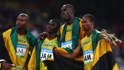 BEIJING - AUGUST 22:  (L-R) Asafa Powell, Nesta Carter, Usain Bolt and Michael Frater of Jamaica celebrate the gold medal after the Men's 4 x 100m Relay Final at the National Stadium on Day 14 of the Beijing 2008 Olympic Games on August 22, 2008 in Beijing, China.  (Photo by Michael Steele/Getty Images)