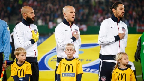 VIENNA, AUSTRIA - NOVEMBER 19:  Goalkeeper Tim Howard, Michael Bradley and Omar Gonzales of USA (L-R) line up for the national anthem prior to the International friendly match between Austria and USA at the Ernst-Happel Stadium on November 19, 2013 in Vienna, Austria.  (Photo by Christian Hofer/Getty Images)