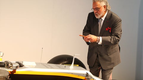 Vijay Mallya takes a photo of the new Force India VJM10 . (Photo: LAT Photographic)