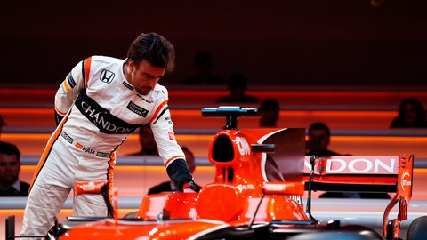 Fernando Alonso inspects the cockpit of the McLaren MCL32 Honda. (Photo: Glenn Dunbar/LAT Photographic)