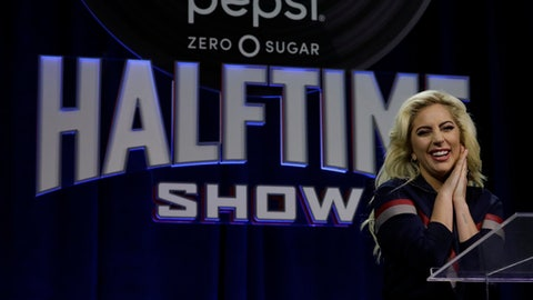 Lady Gaga answers questions at a news conference for the NFL Super Bowl 51 football game Thursday, Feb. 2, 2017, in Houston. (AP Photo/Morry Gash)