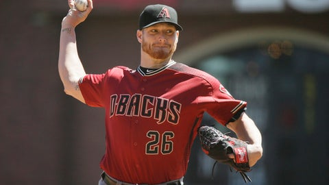 FILE - In this Aug. 31, 2016, file photo, Arizona Diamondbacks starting pitcher Shelby Miller throws in the first inning of a baseball game against the San Francisco Giants in San Francisco. Miller argued his salary arbitration case against Arizona after an awful first season with the Diamondbacks. Miller asked arbitrators for $5.1 million but Arizona argued during a hearing Thursday, Feb. 2, 2017, that he should be paid $4.7 million. (AP Photo/Eric Risberg, File)