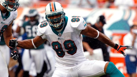 FILE - In this Dec. 11, 2011, file photo, Miami Dolphins outside linebacker Jason Taylor (99) celebrates after sacking Philadelphia Eagles quarterback Michael Vick during the first half of an NFL football game, in Miami. Taylor is a candidate for the Pro Football Hall of Fame. (AP Photo/Hans Deryk, File)