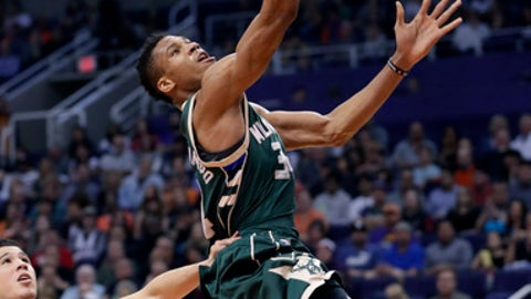 Milwaukee Bucks forward Giannis Antetokounmpo scores against the Phoenix Suns during the first half of an NBA basketball game, Saturday, Feb. 4, 2017, in Phoenix. (AP Photo/Matt York)