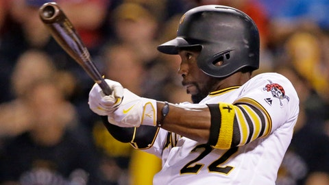 FILE - In this Sept. 23, 2016, file photo, Pittsburgh Pirates' Andrew McCutchen bats during a baseball game against the Washington Nationals, in Pittsburgh. McCutchen's spot in center field was the fulcrum around which the Pittsburgh Pirates swung from laughingstock to contenders. Now it belongs to Starling Marte after McCutchen gracefully opted to pass the torch at his favorite position to pick up the torch at another: right field. (AP Photo/Gene J. Puskar, File)