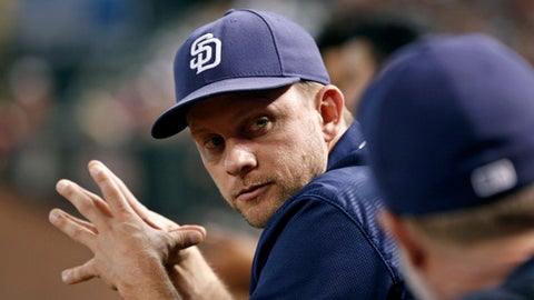 """FILE - In this Oct. 2, 2016, file photo, San Diego Padres manager Andy Green, left, looks toward bench coach Mark McGwire during the sixth inning of a baseball game against the Arizona Diamondbacks in Phoenix. Ever the optimist, Green fully supports general manager A.J. Preller's deep rebuild and suggests that fans """"embrace the process."""" (AP Photo/Ralph Freso, File)"""