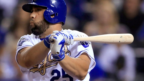 FILE - In this Sept. 16, 2016, file photo, Kansas City Royals designated hitter Kendrys Morales watches his RBI single during the sixth inning of a baseball game against the Chicago White Sox at Kauffman Stadium in Kansas City, Mo. Toronto targeted the switch-hitting Morales to help balance a lineup that was right-handed heavy in 2016, while also hoping his power will play up at Rogers Centre and other hitter-friendly AL East ballparks.  (AP Photo/Orlin Wagner, File)