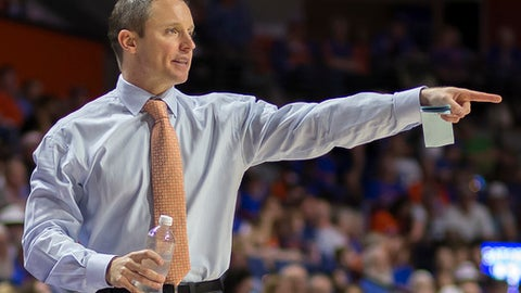 FILE - In this Jan. 14, 2017, file photo, Florida head coach Mike White points instructions to his team during the first half of an NCAA college basketball game against Georgia in Gainesville, Fla. In his second season in Gainesville, White has Florida looking like a lock to return to the NCAA Tournament for the first time in three years. (AP Photo/Ron Irby, File)