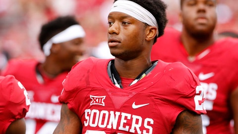 FILE - In this Sept. 19, 2015, file photo, Oklahoma running back Joe Mixon (25) before the start of an NCAA college football game against Tulsa in Norman, Okla. In a video released by the Norman Police Department, Amelia Molitor said a group of men with Mixon sexually harassed her and she rejected Mixon's advances before Mixon punched her and broke bones in her face in July 2014. (AP Photo/Alonzo Adams, File)