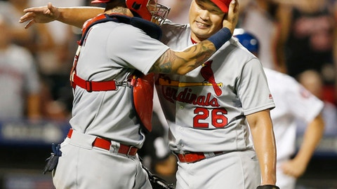 FILE - In this July 27, 2016, file photo, St. Louis Cardinals catcher Yadier Molina, left, and relief pitcher Seung Hwan Oh react after finishing a 5-4 come-from-behind victory over the New York Mets in a baseball game, in New York. Seung-Hwan Oh enjoyed a breakout rookie season for St. Louis, compiling a 1.92 ERA and evolving into the closer. After finishing with 19 saves, the right-handed reliever enters this spring with a clearly defined role at the end of the Cardinals bullpen. (AP Photo/Kathy Willens, File)