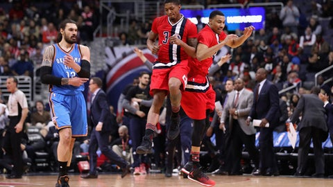WASHINGTON, DC - FEBRUARY 13: Bradley Beal #3 and Otto Porter Jr. #22 of the Washington Wizards celebrate in front of Steven Adams #12 of the Oklahoma City Thunder in the first half at Verizon Center on February 13, 2017 in Washington, DC.  NOTE TO USER: User expressly acknowledges and agrees that, by downloading and or using this photograph, User is consenting to the terms and conditions of the Getty Images License Agreement.  (Photo by Rob Carr/Getty Images)