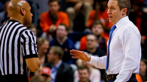 Florida coach Mike White talks with a referee during the first half of the team's NCAA college basketball game against Auburn, Tuesday, Feb. 14, 2017, in Auburn, Ala. (AP Photo/Butch Dill)