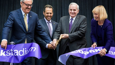 FILE - In this July 22, 2016, file photo, from left to right, Minnesota Vikings co-owners Zygi and Mark Wilf, Gov. Mark Dayton and Michele Kelm-Helgen, the chairwoman of the Minnesota-Sports Facilities Authority, cut the ribbon at the ceremonial grand opening for U.S. Bank Stadium in Minneapolis. In a letter Thursday, Feb. 16, 2017, Kelm-Helgen resigned after weeks of criticism over the questionable use of luxury suites at the stadium by officials' family and friends.(Leila Navidi/Star Tribune via AP, File)